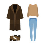 Set of trendy women's clothes with coat, pullover, jeans and boo Royalty Free Stock Photography