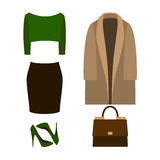 Set of trendy women's clothes with coat, pullover Royalty Free Stock Photos