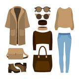 Set of  trendy women's clothes with coat, trousers, pullover  Royalty Free Stock Photography