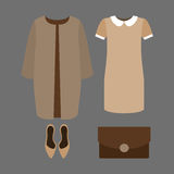 Set of  trendy women's clothes. Outfit of woman coat, dress and Stock Image