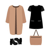 Set of  trendy women's clothes. Outfit of woman coat, dress and Royalty Free Stock Photos