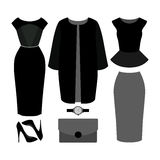 Set of  trendy women's clothes. Outfit of woman coat, dress, ski Stock Images