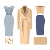 Set of  trendy women's clothes. Outfit of woman coat, dress, ski Stock Image