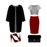 Set of  trendy women's clothes. Outfit of woman coat, skirt, blo Stock Image