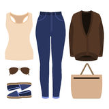 Set of trendy women's clothes. Outfit of woman jeans, cardigan, Stock Images
