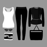 Set of trendy women's clothes. Outfit of woman jeans, jacket, ta Stock Photos
