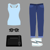 Set of trendy women's clothes. Outfit of woman jeans, tank top a Stock Photos