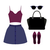 Set of trendy women's clothes. Outfit of woman skirt, top and ac Royalty Free Stock Image