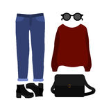Set of trendy women's clothes with pullover, jeans Royalty Free Stock Image