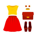 Set of trendy women's clothes with red skirt, yellow top and acc Stock Photography