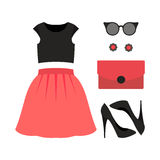 Set of trendy women's clothes with skirt, top and accessories Stock Photo