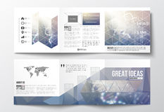 Set of tri-fold brochures, square design templates. DNA molecule structure on a blue background. Science vector. Royalty Free Stock Photo