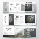 Set of tri-fold brochures, square design templates. Round golden technology pattern on dark background, mandala template Stock Photography