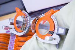 Set of trial lenses for phoropter for eye examination. Close up stock image