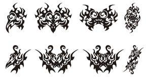 Set of tribal bird head symbols Stock Photos
