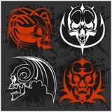 Set of tribal skulls for tattoo. On dark Royalty Free Stock Images