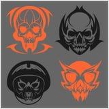 Set of tribal skulls for tattoo. Isolated on dark Stock Photos
