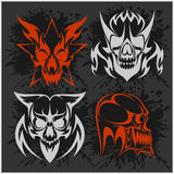 Set of tribal skulls for tattoo. Isolated on dark Royalty Free Stock Photo