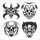 Set of tribal skulls for tattoo. Isolated on white Royalty Free Stock Photos