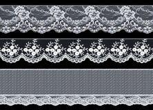 Set trzy eleganckiego biel koronki faborku na czarnym tle L Obraz Stock