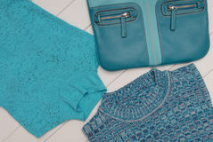 Set of turquoise clothes and bag Royalty Free Stock Photo