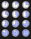 Set of twelve alarms indicating different times Royalty Free Stock Photos