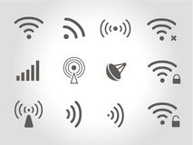 Set of twelve black vector wireless and wifi icons Royalty Free Stock Photos
