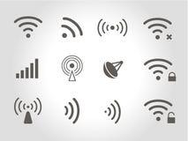 Set of twelve black vector wireless and wifi icons. Set of twelve different black vector wireless and wifi icons for remote access and communication via radio Royalty Free Stock Photos