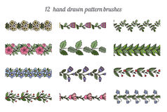 Set of twelve hand drawn pattern floral brushes Stock Photography