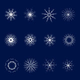 Set of twelve snowflakes on a blue background.One set. Set of twelve snowflakes on a blue background Stock Images