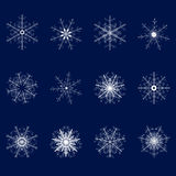 Set of twelve snowflakes on a blue background.The second set. Set of twelve snowflakes on a blue background Royalty Free Stock Photos