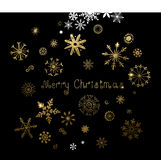 Set of twenty-five hand-drawn gold texture snowflakes and inscription Merry Christmas. Stock Photography