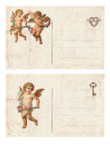 Set of two Antique style valentine`s postcard featuring cupid and heart. Set of two Antique style victorian valentine`s postcard featuring cupid and heart with royalty free stock photography