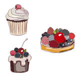Set of two berry tarts and cupcake Stock Images
