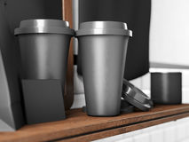 Set of two black take away cups, blank business cards on bookshelf. 3d render Royalty Free Stock Photos