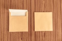 Set of two Brown envelope front and back isolated on wooden table hardwood floor background. Business cards blank. Mockup. Top stock images