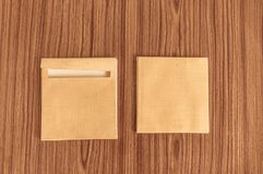 Set of two Brown envelope front and back isolated on wooden table hardwood floor background. Business cards blank. Mockup. Top stock photo