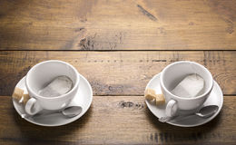 Set of two ceramic tea mugs with tea bags Stock Photos