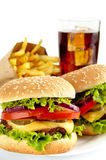 Set of two cheeseburgers,french fries,glass of cola on plate Stock Image