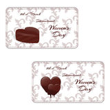 Set of two elegant horizontal gift card with chocolates in the shape of a heart and the words International Women`s Day on 8 March. Vector vector illustration