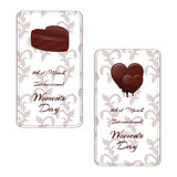 Set of two elegant vertical gift card with chocolates in the shape of a heart and the words International Women`s Day on 8 March. Vector royalty free illustration