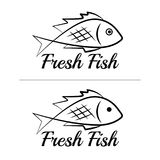 Fresh fish logo symbol icon sign simple black colored set 5. A set of two fish logos, black, sketch style, minimalist with a sample text Royalty Free Stock Photo