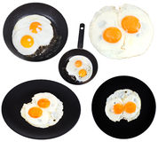 Set from two fried eggs isolated on white Royalty Free Stock Images