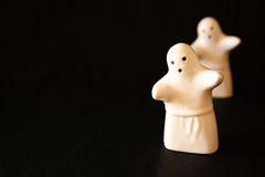 Set of two Halloween ghosts and black background. Royalty Free Stock Photos
