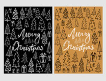 Set of two holiday card template with hand drawn Christmas trees and lettering with black and golden background. Stock Image