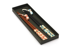 Set of Two Pairs of Chopsticks in Black Case Royalty Free Stock Images