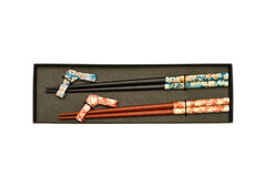 Set of Two Pairs of Chopsticks in Black Case Stock Photos