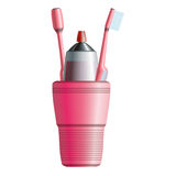 Set of two pink toothbrushes, toothpaste and cup Royalty Free Stock Photo