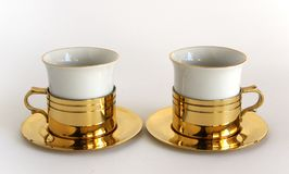 Set of two porcelain cups. In brass holders Royalty Free Stock Image