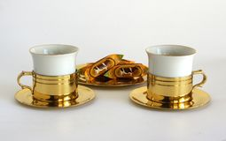 Set of two porcelain cups. In brass holders Royalty Free Stock Images